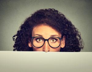Banner sign woman in glasses peeking over edge of blank empty paper billboard
